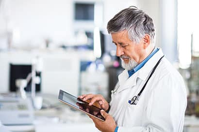 Image Of Doctor With IPad